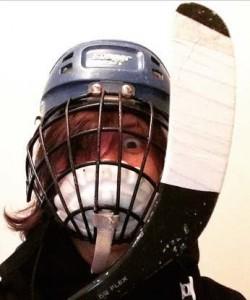 Marsha playing hockey