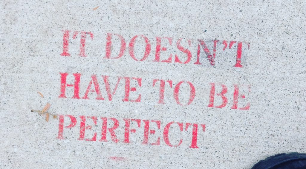 Words written on a stone: it doesn't have to be perfect