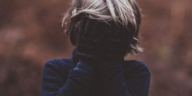 A person hiding his face