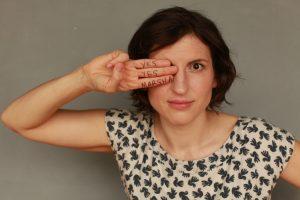 Marsha posing with handwritten on her fingers yes yes Marsha