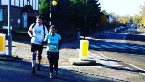 Marsha and Jim jogging along and chatting