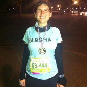 Marsha proudly posing with her plastic medal- she won the MARSHATHON