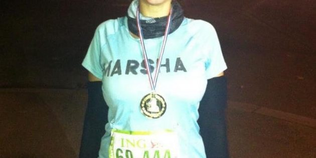Marsha proudly posing with her plastic medal- she won the MARSHATHON
